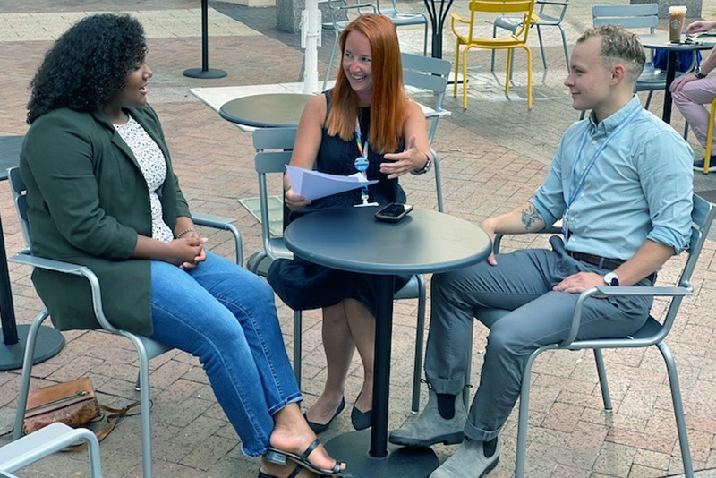 dr frances grimstad meets at a cafe with two of her mentees